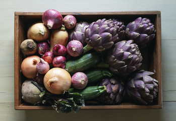 Colorful vegetables in a wooden tray