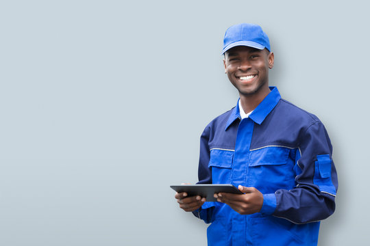 Young African Electrician Holding Mobile Phone