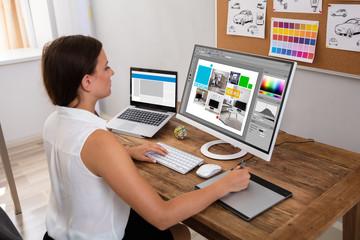 Female Designer Working On Computer