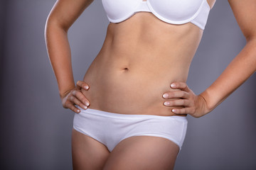 Midsection View Of A Slim Woman