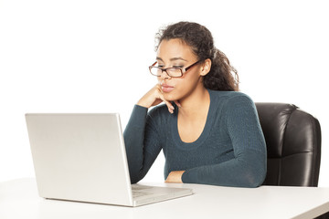 young african-american woman with beautiful face using laptop computer, working project at desk on white background