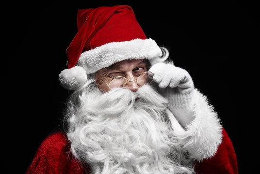 Man in santa claus costume winking