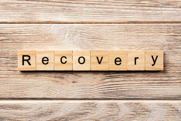 recovery word written on wood block. recovery text on table, concept