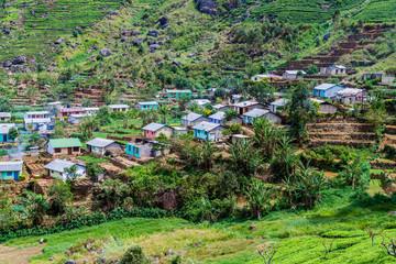 Tea plantations and a small village in mountains near Haputale, Sri Lanka