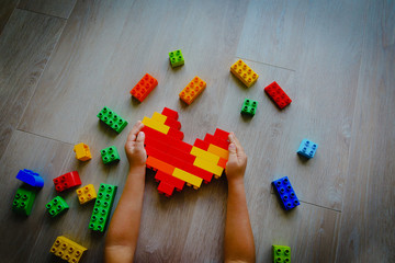 child play with colorful plastic blocks, learning activities for kids