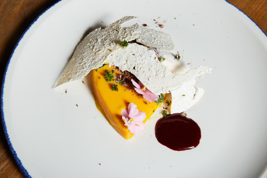 Ice-cream dessert with coconut flowers and mango souffle