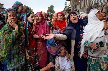Women mourn during the funeral of Nazir Ahmad Wani, a National Conference (NC) party worker, who according to local media was killed after unknown gunmen opened fire on him in Habba Kadal area, in Srinagar
