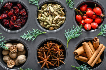 Christmas spices background. Winter spice for baking - cinnamon, anise, nutmeg, cardamom.