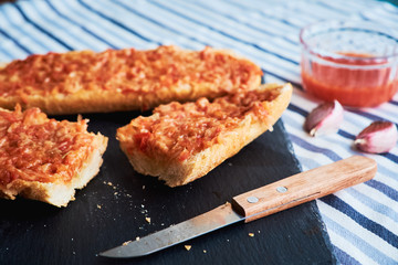 Toast made of baguette, tomatoes and melted cheese