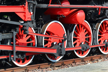 Red painted wheels of a steam locomotive