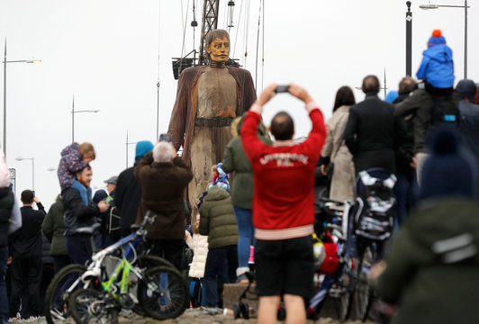 One of Royal Deluxe's giant marionette puppets moves through New Brighton