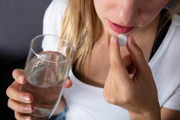 Pregnant Woman Taking Medicine