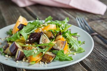 Warm salad with fried eggplant, arugula, cherry tomatoes,