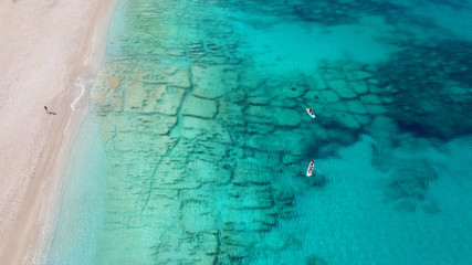 Aerial bird's eye view photo taken by drone of tropical white sandy beach with turquoise clear waters Wall mural