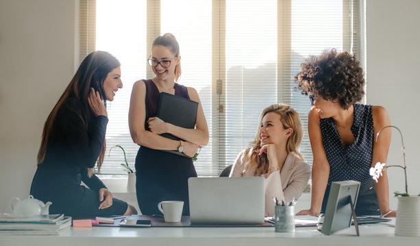 Diverse group of women having a break in office