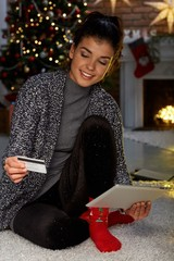 Woman shopping online at home in Christmas