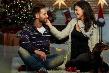 Christmas couple at home in Winter