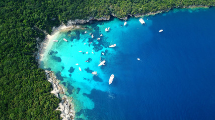 Aerial drone bird's eye view photo of iconic paradise sandy beach of blue lagoon with deep turquoise clear sea and pine trees  in complex island of Mourtos in Sivota area, Epirus, Greece Wall mural