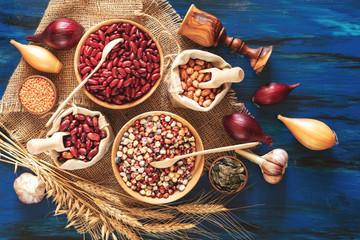 Assortment of kidney bean, indian corn, pumpkin seeds, lentils, onions, garlic