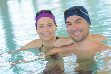 swimming couple in the swimming pool