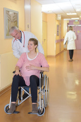 pregnant woman being pushed on the wheelchair