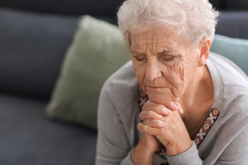 Depressed elderly woman at home Wall mural