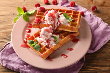 Delicious waffles with berry jam and ice cream on plate