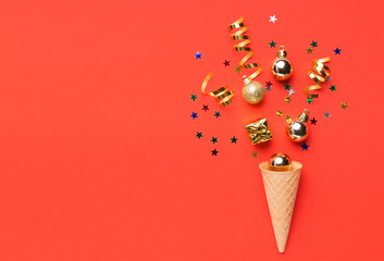 Ice cream cone with colorful streamers on red