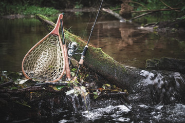 Fishing gear on the background of a picturesque forest river.