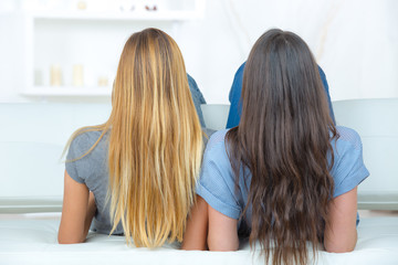 Rear view of two girls with long hair