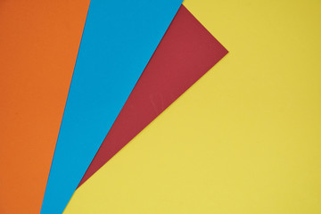 red, blue and orange on yellow background