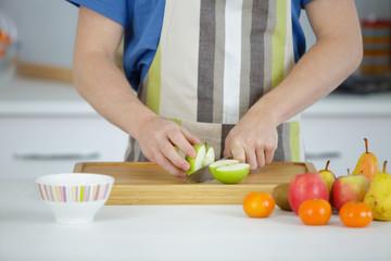 man cutting apples