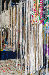women's beads and necklace hanging in the exhibition