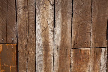 Texture of old brown wood slats. Aged and deteriorated by the passage of time.