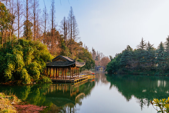 Traditional Chinese pavilion by water near West Lake in Hangzhou, China