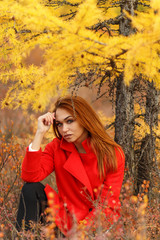 Woman in an autumn forest