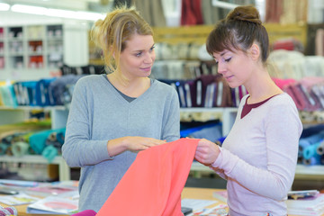 two female customers selecting sleeping clothes in clothes store