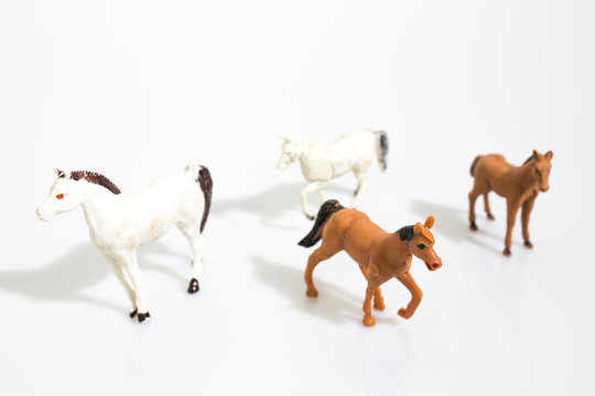 Christmas objects, plastic animals horses  for nativity diorama isolated in a white background