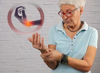 Senior Woman suffering from Wrist Pain , arthritis