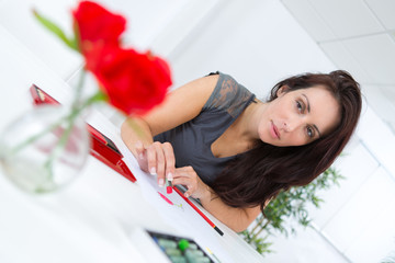 Woman sketching flowers