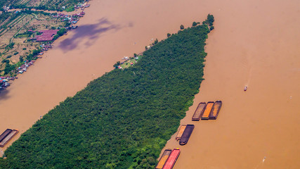 aerial picture of empty barges waiting to be loaded near the coal stockpile. this picture was taken in Borneo, Indonesia