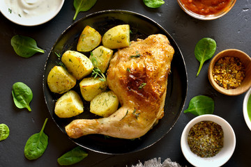 Baked chicken leg with potato