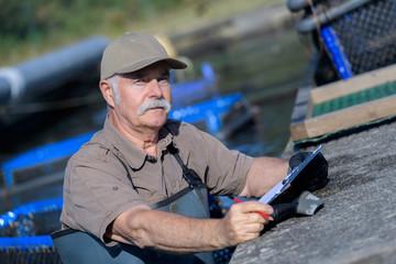 senior fishermen and the fish farm