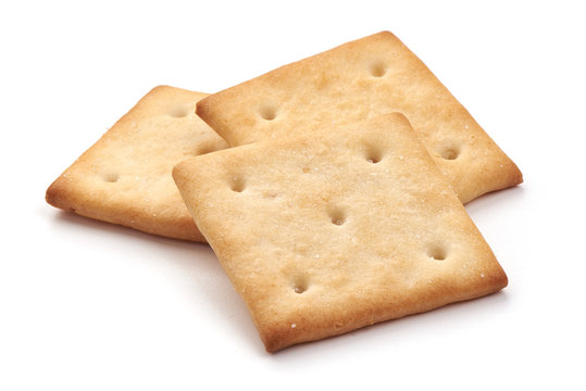 Salted cracker biscuit, close-up, isolated on white background.