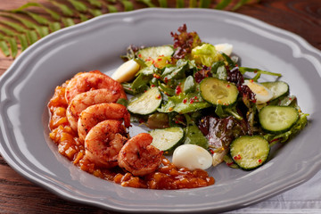 Healthy salad with grilled shrimps