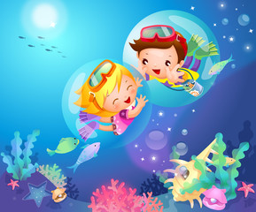 Side profile of a boy and a girl swimming underwater