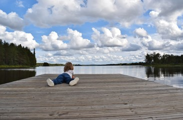 toddler on the lake pier.