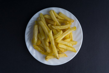 Potato fry or fries on dark background