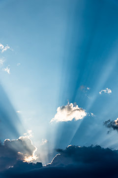 A sunbeam looks out from behind the clouds
