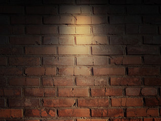 brick wall and spotlight.  scene illuminated spotlight.  bricks wall background.